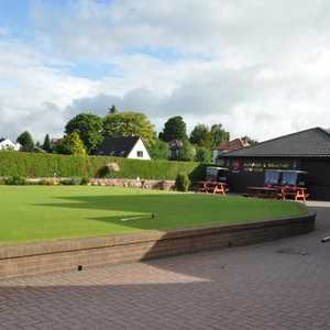 The clubhouse and putting green at Dumfries & Galloway Golf Club