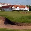 A view of the 18th green from the Kintyre course at Trump Turnberry Resort with the clubhouse in background.