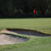 A view of green guarded by sand traps at Alness Golf Club