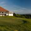 A view of the clubhouse with putting green in foreground at Skelmorlie Golf Club
