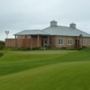 A view of the clubhouse and the putting green at McDonald Golf Club